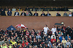 Supporters of Irish club Bohemians  and UEFA officials watching the action at Park Hall Stadium, Oswestry during the Champions League 2nd qualifying round 2nd leg game away to The New Saints. Despite leading 1-0 from the first leg, the Dublin club went out following their 4-0 defeat by the Welsh champions. The match was the first-ever Champions League match in the UK played on an artificial pitch and was staged at the Welsh Premier League's ground which was located over the border in England.