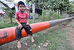 A Guatemalan boy lives beside an oil pipeline that crosses the large section of the north of the Central American country.