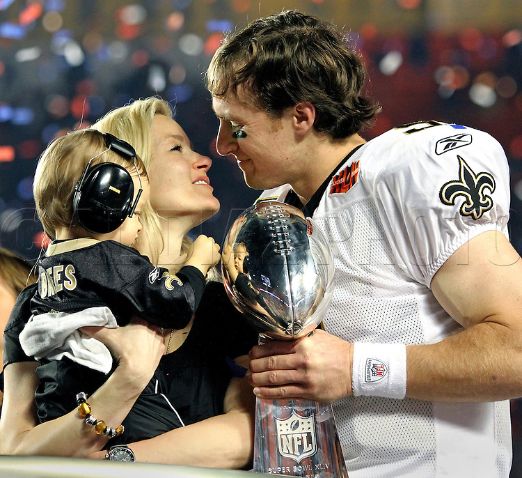 New Orleans Saints quarterback Drew Brees (9) leans in to kiss his wife, Brittany Brees, and their one-year-old son Baylen Robert Brees, while he holds the Vince Lombardi Trophy after the Saints won the 2010 Super Bowl game Sunday, February 7, 2010, at Sun Life Stadium in Miami Gardens, Fla.