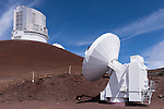 Mauna Kea, Big Island of Hawaii, Hawaii; a Submillimeter Radio Telescope located at the summit of the Mauna Kea Observatories (MKO), with the Subaru Telescope and the Keck 1 Telescope in the background, currently there are 13 independent multi-national astronomical research facilities located on the summit. Mauna Kea's altitude and isolation in the middle of the Pacific ocean make it an ideal location for astronomical observation.