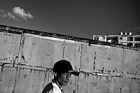 Yuri C., a Cuban hip-hop fan and musician, poses for a picture in front of the apartment block in Alamar, a large public housing complex in the Eastern Havana, Cuba, 9 February 2009.