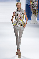 Anabela Belikova walks runway in a White psychedelic printed chiffon v-neck drawstring top with stretch cotton criss cross cutaway overlay and printed peplum drawstring belt, and Grey textured gauze legging, by Vera Wang, for the Vera Wang Spring 2012 collection, during Mercedes-Benz Fashion Week Spring 2012.