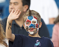 New England Revolution fan. In a Major League Soccer (MLS) match, Toronto FC (white/red) defeated the New England Revolution (blue), 1-0, at Gillette Stadium on August 4, 2013.