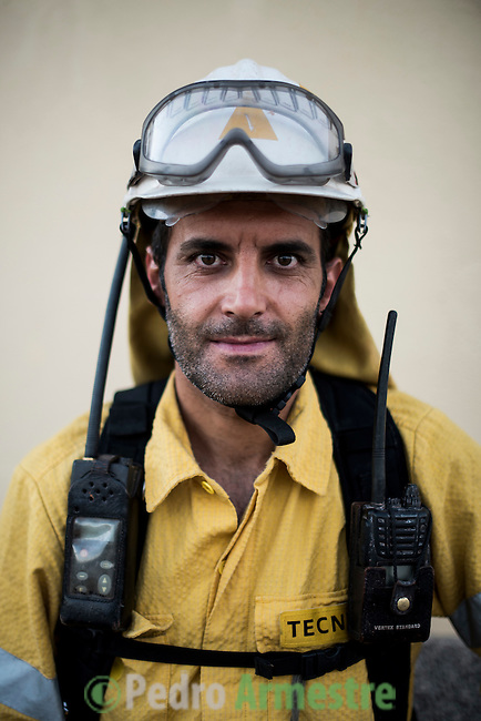 Francisco Cantero. Forestry Operations Technician. The firefighter from the BRICA Málaga 703, the Andalusian Service firefighting (INFOCA),  posses after a wildfire in Los Barrios near Cadiz on July 25, 2015. © Pedro ARMESTRE