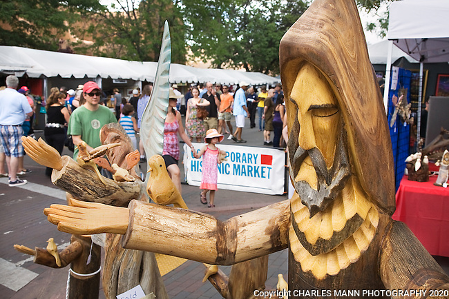The Santa Fe Spanish Market, held in late July, fills the Santa Fe Plaza with artists, patrons and visitors all celebrating the richness of the Spanish Colonial art tradition side by side with the Contemporary Spanish Art Market. Artist Pete Ortega carves large soulful santos,or statues of the saints, from wood.