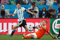 Lionel Messi of Argentina and Ron Vlaar of the Netherlands