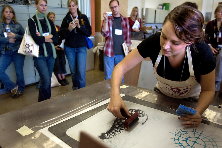 "Artist Johanna Paas makes a print during the 2006 Mid America Print Council conference ""Forging Connections"" at Ohio University on Friday, 9/22/06. The conference runs from September 20-23. Around 700 printmakers, students, curators and other art professionals are expected to attend the biennial event."