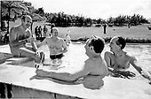 Talks on problems like the energy crisis continued even in the swimming pool at the Leyritz Hotel in Martinique on December 15, 1974.  From left to right French President Valery Giscard d'Estaing, United States President Gerald R. Ford, United States Secretary of State Henry Kissinger, and French Foreign Minister Jean-Paul Sauvagnargues relax during their meeting in Martinique, F.W.I.<br /> Mandatory Credit: David Hume Kennerly / White House via CNP