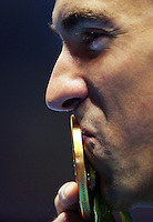 RIO DE JANEIRO, BRAZIL - AUGUST 09:  Michael Phelps of the USA kisses his medal with a tear in his eye after winning Gold in the Men's 200m Butterfly Final on Day 4 of the Rio 2016 Olympic Games at the Olympic Aquatics Stadium on August 9, 2016 in Rio de Janerio, Brazil.  (Photo by Vaughn Ridley/SWpix.com)
