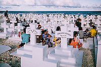 People gathered in one of the Ebeye's cemeteries.