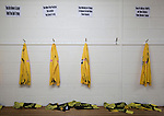 Belper Town v Gresley, 28/01/2014. Christchurch meadow, Northern Premier League. Home team strips hanging on pegs in the dressing room before Belper Town's match against Gresley, in a Northern Premier League, first division south fixture at Christchurch meadow. The home side have played at their current ground since the club was reformed in 1951. Belper won this fixture against their local Derbyshire rivals by 4 goals to 1 watched by a crowd of 165 spectators. Photo by Colin McPherson.