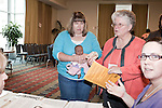 "March 11, 2010. Raleigh, North Carolina.. The first N.C. Poverty Simulation Experience training session was held at the 40th Annual State Head Start Conference at the Raleigh Convention Center.  . Nearly 60 individuals, including staff and parents from Head Start programs and Community Action Agencies, engaged in role playing exercises that hoped to simulate the experience of being poor and what the poor go through on a daily basis.. Anyone playing the role of a child one year old or younger was given a doll. Here the ""family"" goes to the Social Services office."