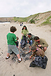 Pacific Elementary School Students & Teachers On Beach Cleanup