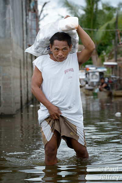 Community battles chronic flooding in the Philippines ...