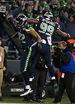 Seattle Seahawks  defensive end Michael Bennett and Tony McDaniel, celebrate Bennett's fumble  returns for a 22-yard touchdown against the New Orleans Saints during the first quarter at CenturyLink Field in Seattle, Washington on December 2, 2013. The Seahawks beat the Saints 34-7 to take the best record team in the NFL.©2013. Jim Bryant Photo. ALL RIGHTS RESERVED.