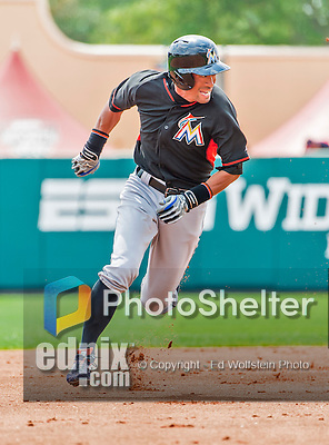 19 March 2015: Miami Marlins outfielder Ichiro Suzuki hustles to third during Spring Training action against the Atlanta Braves at Champion Stadium in the ESPN Wide World of Sports Complex in Kissimmee, Florida. The Braves defeated the Marlins 6-3 in Grapefruit League play. Mandatory Credit: Ed Wolfstein Photo *** RAW (NEF) Image File Available ***
