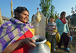A woman fills a container with water at a community spigot in Makaising, a village in the Gorkha District of Nepal where a church-sponsored aid group has provided a variety of support--including rehabilitating the community's damaged water system--to local villagers in the wake of a devastating 2015 earthquake.
