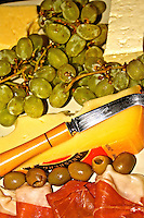 cheese platter with grapes olives cold meat cuts photo