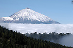 Mount Teide with a capping of snow and cloud.Tenerife, Canary Islands,Spain