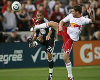 Fred (27) of D.C. United crosses the ball past Teemu Tainio (2) of the New York Red Bulls during an MLS match at RFK Stadium, in Washington D.C. on April 21 2011. Red Bulls won 4-0.