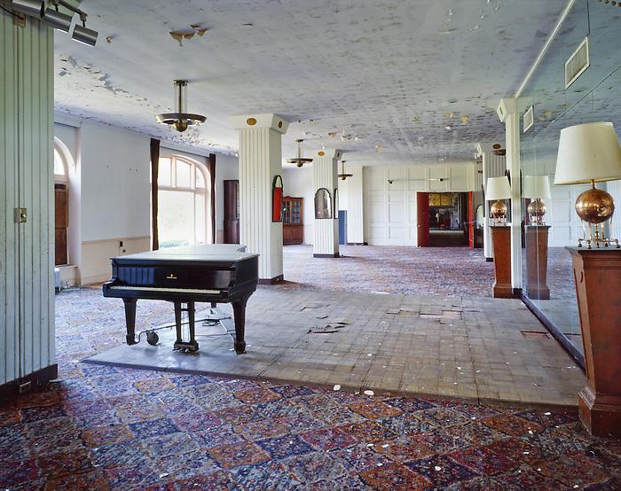 The Ballroom and Piano of the Abandoned Buck Hill Falls Inn in the Pocono's of Pennsylvania