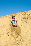 Emeryville CA Girl, six-year-sold inventing slide in construction debris site  MR