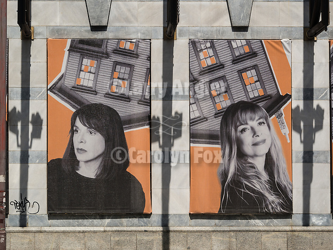 Faces of two women as posters along a street in Belgrade, Serbia