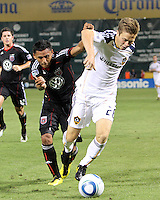 Andy Najar #14 of D.C. United tussles with Michael Stephens #26 of the Los Angeles Galaxy during an MLS match at RFK Stadium on July 18 2010, in Washington D.C. Galaxy won 2-1.