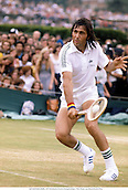 ILIE NASTASE (ROM), 1977 Wimbledon Tennis Championships, 7706. Photo: Leo Mason/Action Plus...1977.man