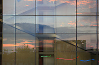 Paul-Lobe-Haus reflecting the sunset skies, architect Stephane Braunfels, 2001, a government building for the new parliamentary complex in the new government quarter of Berlin, on the banks of the river Spree on Federal Row, Berlin, Germany. It is connected to the Chancellery and together with the Marie-Elisabeth-Luders House on the opposite side of the Spree it forms a formal and functional whole. The building contains more than 900 offices for the parliamentary deputies. It is named after Paul Lobe, 1875-1967, the last democratic president of the Weimar Republic. Picture by Manuel Cohen