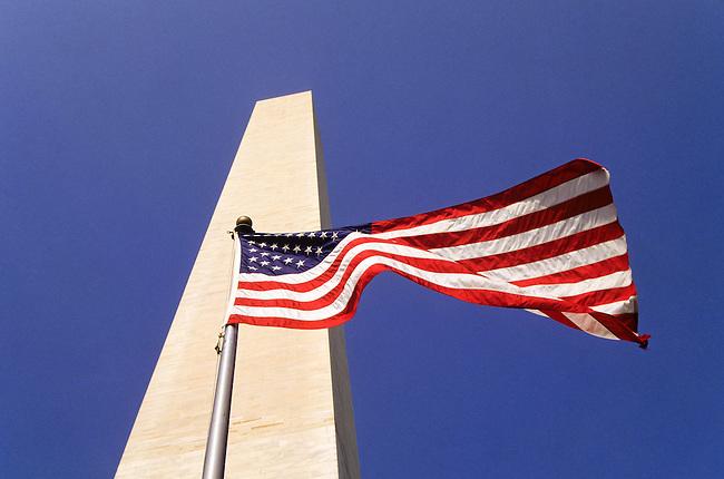 Washington Monument with a flag in Washington DC, USA