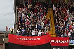 Crusaders supporters celebrating their cteam's equalising goal at Seaview Park, Belfast as the Northern Irish club take on Fulham in a UEFA Europa League 2nd qualifying round, fist leg match. The visitors from England won by 3 goals to 1 before a crowd of 3011.