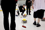 Jeff Hedgepeth watches a stone slide into the scoring range during a practice at the Triangle Curling Club inside The Factory in Wake Forest, Friday, Feb. 7, 2010.