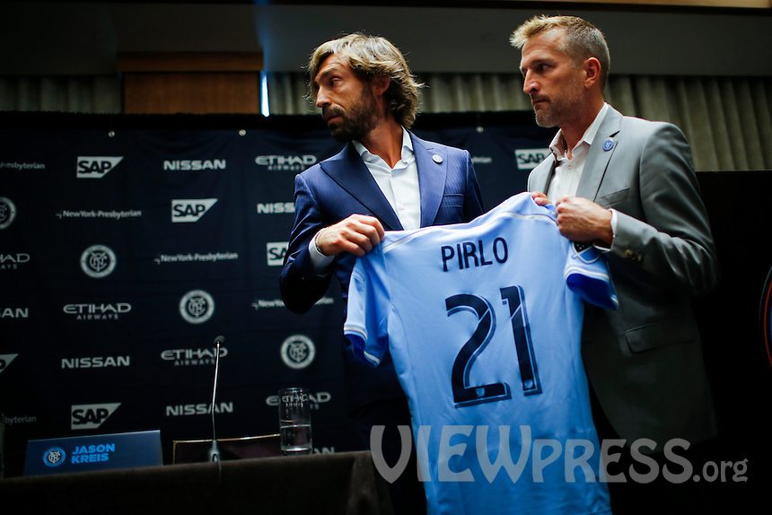 Andrea Pirlo and Head Coach, Jason Kreis pose with the jersey as they attend a press conference with his new team New York City FC at Manhattan in New York. 07.23.2015.  Eduardo MunozAlvarez/VIEWpress.