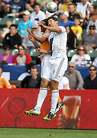 CARSON, CA - DECEMBER 01, 2012:   Omar Gonzalez (4) of the Los Angeles Galaxy goes up for a header with Calen Carr (3) of the Houston Dynamo during the 2012 MLS Cup at the Home Depot Center, in Carson, California on December 01, 2012. The Galaxy won 3-1.
