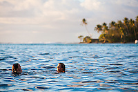 Young women swimming in  crystal clear lagoon