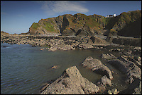BNPS.co.uk (01202 558833)<br /> Pic: Jackson-Stops/BNPS<br /> <br /> ****Must use full byline****<br /> <br /> Tides shot from the beach.<br /> <br /> A stunning cliff-top house has grown into a 1.25 million pounds property after it was built on a disused allotment.<br /> <br /> Jamie and Zoe McLintock forked out &pound;80,000 for the overgrown plot of land eleven years ago because it was atop a cliff along Devon's craggy coastline.<br /> <br /> The enterprising couple spent a further &pound;600,000 and three years of their time building the beautiful five-bedroom pad.<br /> <br /> But they are now set to double their money after the incredible property went on the market for a whopping &pound;1.25 million with estate agents Jackson-Stops.<br /> <br /> The white-washed three-storey house is perched on top of 100ft cliffs overlooking Tunnels Beaches in Ilfracombe, a stretch of private Victorian beach owned by the couple since 2001.