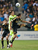 CARSON, CA – July 4, 2011: Seattle Sounders midfielder Alvaro Fernandez (15) and LA Galaxy midfielder Landon Donovan (10) during the match between LA Galaxy and Seattle Sounders FC at the Home Depot Center in Carson, California. Final score LA Galaxy 0, Seattle Sounders FC 0.