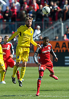31 March 2011: Columbus Crew midfielder/forward Eddie Gaven #12 and Toronto FC defender Ashtone Morgan #5 in action during a game between the Columbus Crew and the Toronto FC at BMO Field in Toronto, Ontario Canada..The Columbus Crew won 1-0.