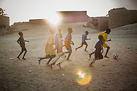 Children play football in the sand in the town of Gao. /Felix Features