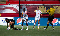 Shade Pratt (22) of Maryland disagrees with the referee's call after Katie Stengel (12) of Wake Forest goes down to the ground during the game at Ludwig Field in College Park, MD.  Maryland defeated Wake Forest, 1-0.