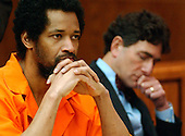 Manassas, VA - March 9, 2004 -- Convicted Beltway Sniper John Allen Muhammad, left, listens to testimony as his attorney Jonathan Shapiro, right, is deep in thought prior to being sentenced the shooting of Dean Meyers at the Prince William County (Virginia) Circuit Court in Manassas, Virginia on March 9, 2004.  A Virginia Beach (Virginia) jury convicted Muhammad and reccommended the death sentence for his role in the fall, 2002 DC Sniper shootings. The judge upheld the jury's reccomendation. .Credit: Steve Helber - Pool via CNP