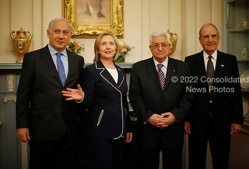 United States Secretary of State Hillary Clinton, 2nd left, gathers with Prime Minister Benjamin Netanyahu of Israel, left, President Mahmoud Abbas  of the Palestinian Authority, 2nd right, and George Mitchell, U.S. Special Envoy for Middle East Peace, left, in the Monroe Room of the State Department, before their direct talks aimed at peace in the Middle East, in Washington, Thursday, September 2, 2010.     .Credit: Jason Reed / Pool via CNP