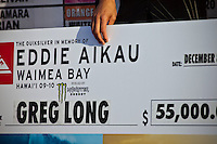 """WAIMEA BAY, Oahu/Hawaii (Tuesday, December 8, 2009) Greg Long's check. - The Quiksilver In Memory of Eddie Aikau,  was officially  called """"ON"""" by Contest Director George Downing this morning. The ASP specialty sanctioned event kicked off at 8am with wave face heights in the 25-35-foot range..Nine times world champion Kelly Slater (USA) led for most of the day until Greg Long(USA) scored his best four scoring rides in the last heat of the day to over take Slater. Long scored a perfect 100 point wave late in the day to seal the first prize purse of $55,000. Slater was runner up with Sunny Garcia (HAW) in 3rd, defending champion Bruce Irons (HAW) 4th and Ramon Navarro (CHL)  in 5th place. Navarro won the Monster drop award for the biggest drop, also in the final heat of the day when wave faces were pushing 40' plus...The northern hemisphere winter months on the North Shore signal a concentration of surfing activity with some of the best surfers in the world taking advantage of swells originating in the stormy Northern Pacific. Notable North Shore spots include Waimea Bay, Off The Wall, Backdoor, Log Cabins, Rockpiles and Sunset Beach... Ehukai Beach is more  commonly known as Pipeline and is the most notable surfing spot on the North Shore. It is considered a prime spot for competitions due to its close proximity to the beach, giving spectators, judges, and photographers a great view...The North Shore is considered to be one the surfing world's must see locations and every December hosts three competitions, which make up the Triple Crown of Surfing. The three men's competitions are the Reef Hawaiian Pro at Haleiwa, the O'Neill World Cup of Surfing at Sunset Beach, and the Billabong Pipeline Masters. The three women's competitions are the Reef Hawaiian Pro at Haleiwa, the Gidget Pro at Sunset Beach, and the Billabong Pro on the neighboring island of Maui...Photo: Joliphotos.com"""