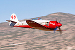 "Piloted by Shuttle Astronaut Robert ""Hoot"" Gibson the Hawker Sea Fury Race 99, ""Riff Raff,"" flies down the ""Valley of Speed"" during an Unlimited Class heat race at the 2006 Reno National Championship Air Races. Robert finished a strong 4th place overall in the 2006 event. Photographed 09/06"