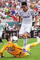 Jose Maria Callejon (21) of Real Madrid beats Celtic F. C.goalkeeper Lukasz Zaluska (24) to score during a 2012 Herbalife World Football Challenge match at Lincoln Financial Field in Philadelphia, PA, on August 11, 2012.