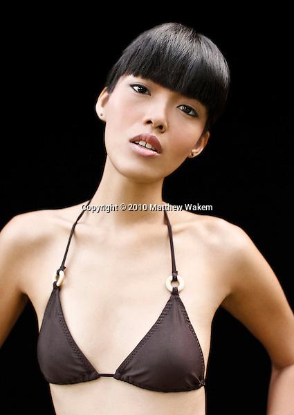Portrait of young Asian woman in bikini, Kayumanis Ubud, Bali, Indonesia.