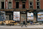 A man walks past abandoned buildings in Manhattan's Lower East Side.