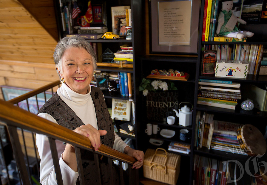 NWA Democrat-Gazette/JASON IVESTER<br /> Jo Lightfoot; photographed on Tuesday, Jan. 26, 2016, in her favorit place, a bookshelf in the stairwell of her Lowell home for Personal Space