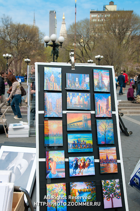 Stand with colorful paintings in Union Square Park